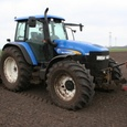 New Holland TM140 met hakfrees