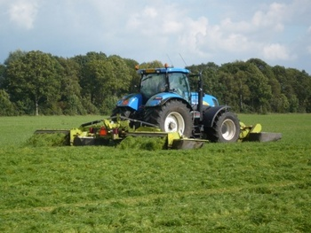 New Holland T7050 met Claas Triple maaier